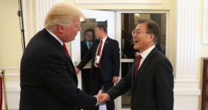 Hamburg: South Korean President Moon Jae-in shakes hands with U.S. President Donald Trump before a three-way meeting with Japanese Prime Minister Shinzo Abe at the U.S. consulate in Hamburg on July 6, 2017. (Yonhap/IANS) by .