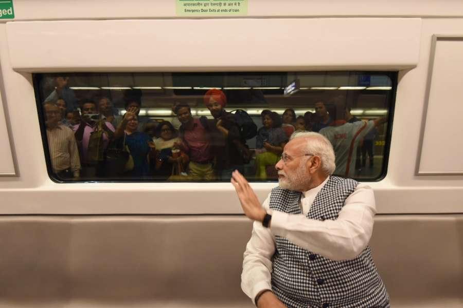 New Delhi: Prime Minister Narendra Modi takes Delhi Metro ride on his way to inaugurate Ambedkar National Memorial at 26 Alipur Road in New Delhi on April 13, 2018. (Photo: IANS/PIB) by .