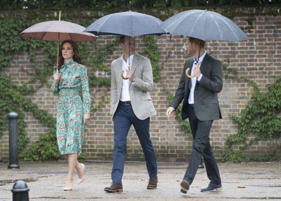 LONDON, Aug. 30, 2017 (Xinhua) -- Prince William (C), the Duke of Cambridge, and his wife Catherine, the Duchess of Cambridge and Prince Harry arrive at the White Garden in the grounds of Kensington Palace in London, Britain on Aug. 30, 2017 to commemorate the 20th anniversary of the death of Princess Diana. (Xinhua/IANS) by .