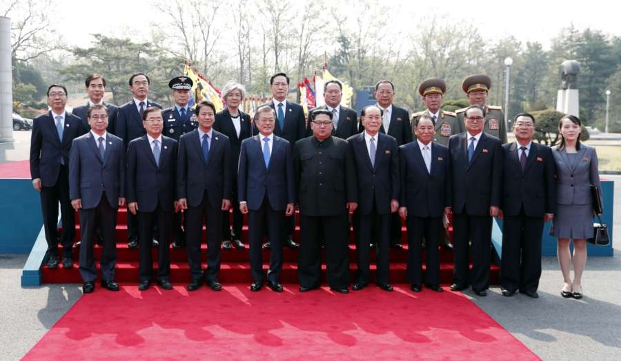Panmunjom: South Korean President Moon Jae-in (4th from L) and his North Korea counterpart Kim Jong-un (5th from L) pose for a photo with their entourages after a ceremony to welcome Kim prior to their talks at the Peace House of the truce village of Panmunjom on April 27, 2018. (Yonhap/IANS) by .
