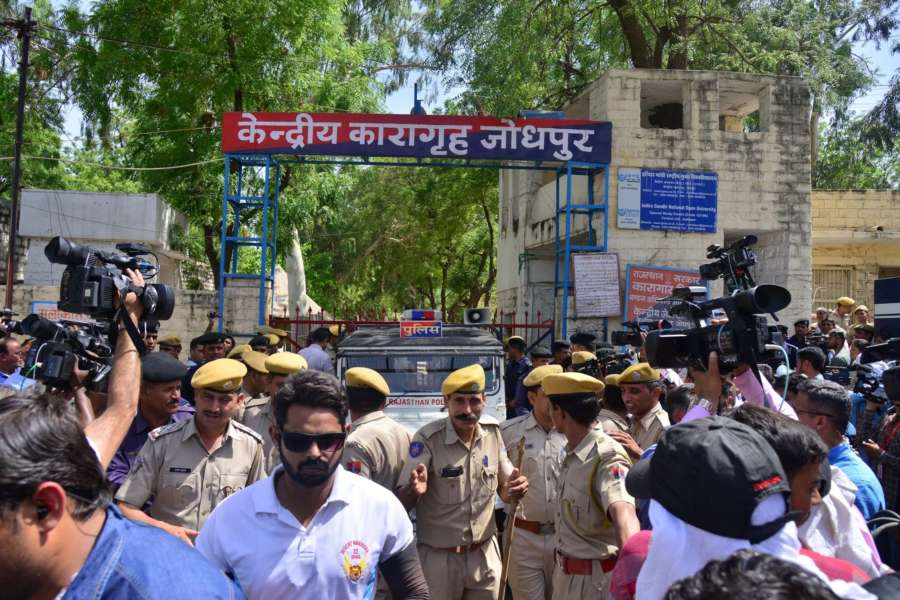 Jodhpur: Self-styled godman Asaram Bapu being taken to be produce before Jodhpur court, outside Jodhpur Central Jail on April 25, 2018. Asaram was on Wednesday convicted by a Jodhpur court for raping a minor girl at his ashram here in Rajasthan in 2013 and sentenced to a life term. Asaram, lodged in Jodhpur Jail in Rajasthan after his arrest in 2013, has been accused of sexually assaulting a 16-year-old girl. He has denied the charge. (Photo: IANS) by .