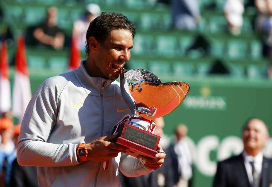 ROQUEBRUNE-CAP-MARTIN, April 23, 2018 (Xinhua) -- Rafael Nadal of Spain poses with his trophy during the awarding ceremony after the final against Kei Nishikori of Japan at the 2018 Monte-Carlo Masters in Roquebrune-Cap-Martin, France on April 22, 2018. Rafael Nadal claimed the title by defeating Kei Nishikori with 2-0. (Xinhua/Nicolas Marie/IANS) by .