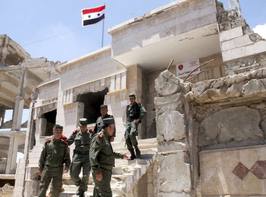 HOMS, May 16, 2018 (Xinhua) -- Syrian policemen gather in front of a building in the city of Rastan, in the northern countryside of Homs province in central Syria, on May 16, 2018. The last batch of rebels and their families has been evacuated Wednesday out of Syria's central province of Homs, local officials told Xinhua. TO GO WITH Roundup:Last batch of rebels evacuate Syria's Homs (Xinhua/Hummam Sheikh Ali/IANS) by .