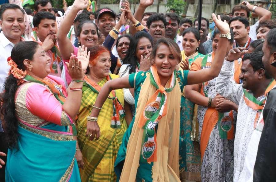 Bengaluru: Congress workers celebrate after Congress candidate Muniratna won Rajarajeshwari Nagar assembly seats in the bypoll; in Bengaluru on May 31, 2018. (Photo: IANS) by .