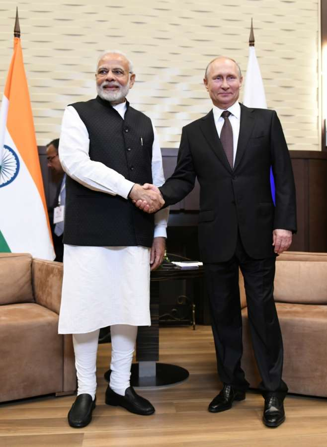 Sochi: Prime Minister Narendra Modi meets Russian President Vladimir Putin in Sochi, Russia on May 21, 2018. (Photo: IANS/MEA) by .