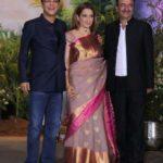 Mumbai: Filmmakers Vidhu Vinod Chopra and Rajkumar Hirani with actress Kangana Ranaut at the wedding reception of actress Sonam Kapoor and businessman Anand Ahuja in Mumbai, on May 8, 2018. (Photo: IANS) by .