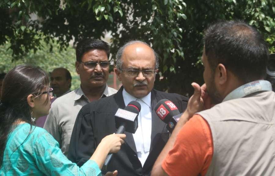 New Delhi: Lawyer Prashant Bhushan addressing media on CJI impeachment case at Supreme Court lawn in New Delhi on May 8, 2018. (Photo: IANS) by .