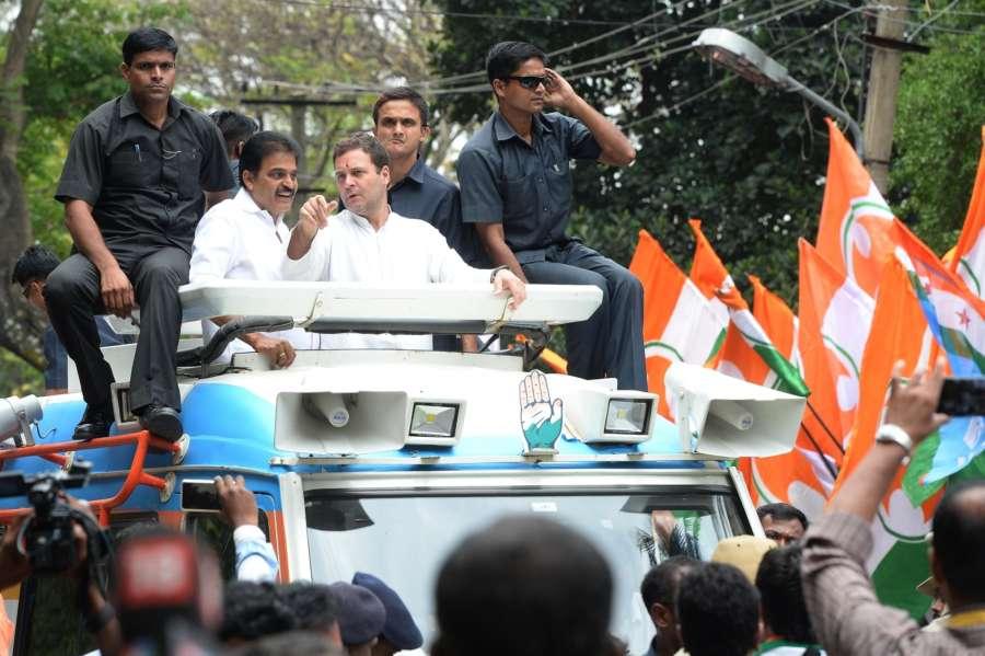 Bengaluru: Congress President Rahul Gandhi during a roadshow ahead of Karnataka Assembly polls in Bengaluru, on May 9, 2018. (Photo: IANS) by .