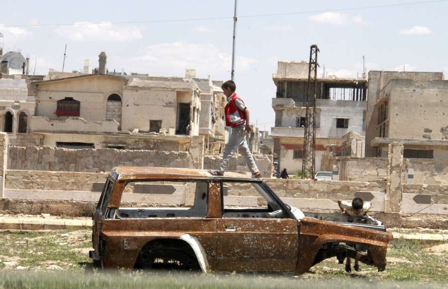 HOMS, May 16, 2018 (Xinhua) -- Syrian boys play on a damaged car in the city of Talbiseh, in the northern countryside of Homs province in central Syria, on May 16, 2018. The last batch of rebels and their families has been evacuated Wednesday out of Syria's central province of Homs, local officials told Xinhua. TO GO WITH Roundup:Last batch of rebels evacuate Syria's Homs (Xinhua/Hummam Sheikh Ali/IANS) by .