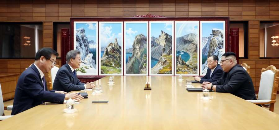 Panmunjom: In this photo provided by Cheong Wa Dae, South Korean President Moon Jae-in (2nd from L) speaks with North Korean leader Kim Jong-un (R) during their summit at Tongilgak on the northern side of Panmunjom in the Demilitarized Zone on May 26, 2018. Next to Moon is South Korea's National Intelligence Service chief Suh Hoon. To Kim Jong-un's right is Kim Yong-chol, a vice chairman of the central committee of the Workers' Party Korea and head of the North's United Front Department handling inter-Korean relations. (Yonhap/IANS) by .