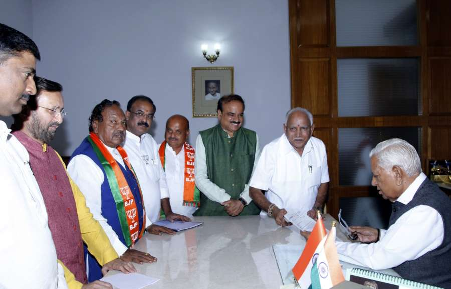 Bengaluru: BJP's chief ministerial candidate in Karnataka B. S. Yeddyurappa along with party leaders Ananth Kumar, Prakash Javadekar and Muralidhar Rao, meets Karnataka Governor Vajubhai Vala to stake claim to form the government though the party is eight seats short of a majority in the Assembly; in Bengaluru on May 16, 2018. (Photo: IANS) by .