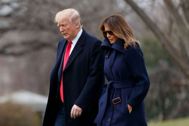 WASHINGTON, March 19, 2018 (Xinhua) -- U.S. President Donald Trump (L) and First Lady Melania Trump depart the White House in Washington D.C., the United States, on March 19, 2018. U.S. President Donald Trump on Thursday suggested