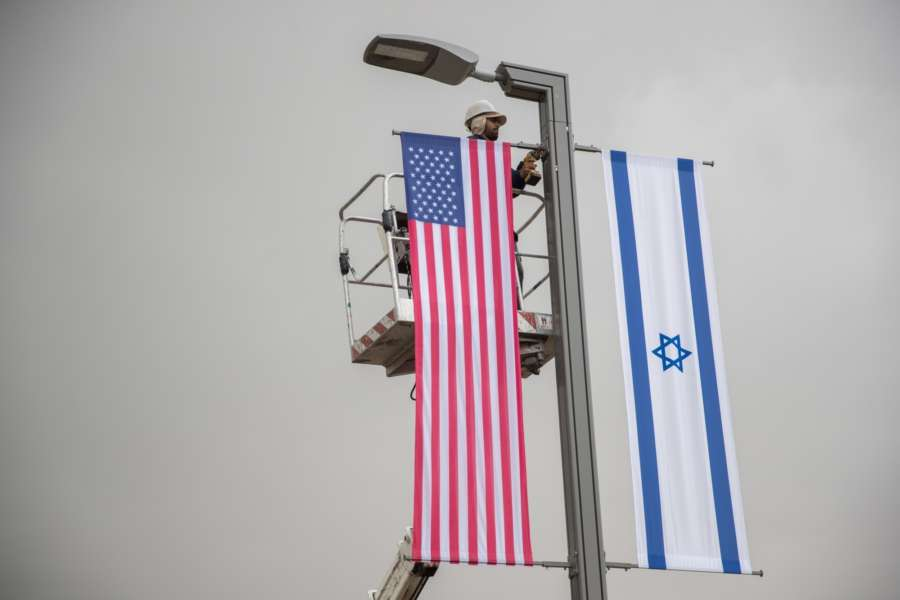 JERUSALEM, May 7, 2018 (Xinhua) -- A Jerusalem municipal worker installs U.S. and Israeli flags near the U.S. Consulate General in Jerusalem, on May 7, 2018. U.S. President Donald Trump on Monday announced the designation of a presidential delegation to Israel to attend the opening of the U.S. embassy. According to a White House statement, the opening ceremony will be on May 14. (Xinhua/JINI/IANS) by .