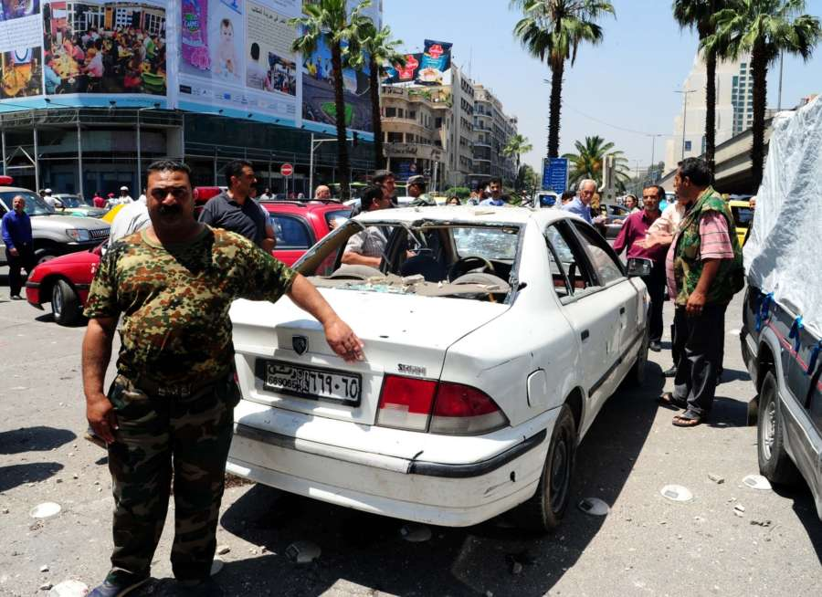 DAMASCUS, May 16, 2018 (Xinhua) -- Photo taken on May 16, 2018 shows a damaged car at a rocket attack site in the surrounding of Victoria Bridge area of Damascus, Syria. (Xinhua/Ammar Safarjalani/IANS) by .