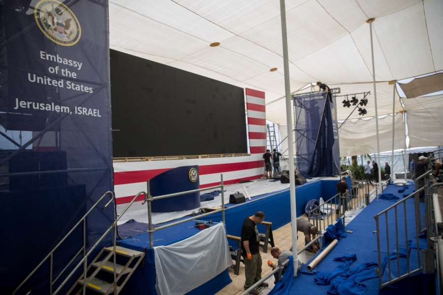 JERUSALEM, May 13, 2018 (Xinhua) -- Workers prepare the stage for the opening ceremony of the new U.S. embassy in Jerusalem on May 13, 2018. Israel prepares on Sunday for the opening ceremony of the new U.S. embassy in Jerusalem on Monday, a move that has sparked Palestinian protests. (Xinhua/JINI/IANS) by .