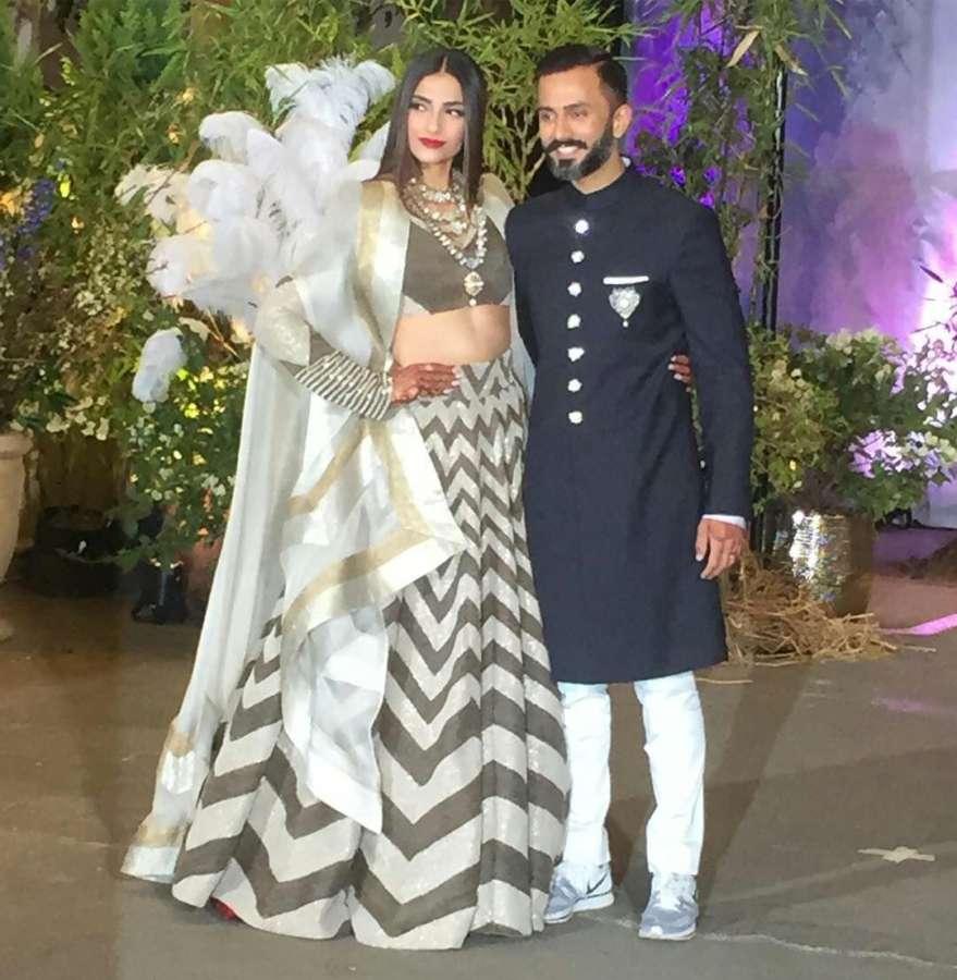 Mumbai: Actress Sonam Kapoor and Anand Ahuja at their wedding reception in Mumbai, on May 8, 2018. (Photo: IANS) by .