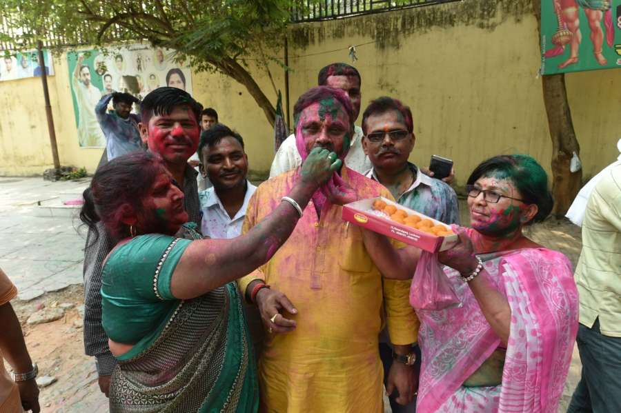 Lucknow: Rashtriya Lok Dal (RLD) workers celebrate after their party wrested the Kairana Lok Sabha seat from BJP in the bye election; at the party office in Lucknow on May 31, 2018. (Photo: IANS) by .