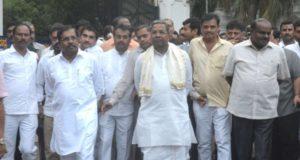 Bengaluru: JD(S) leader H D Kumarswamy with outgoing Karnataka Chief Minister Siddaramaiah and Congress state president G Parameshwara arrive to address the media after meeting Karnataka Governor Vajubhai Vala at Raj Bhavan, in Bengaluru on May 15, 2018. (Photo: IANS) by .