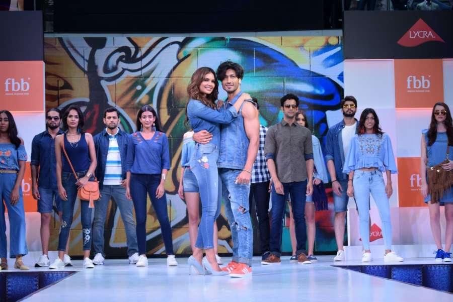 Mumbai: Actors Esha Gupta and Vidyut Jamwal walk the ramp for FBB Fashion Hub, in Mumbai on April 28, 2018. (Photo: IANS) by .