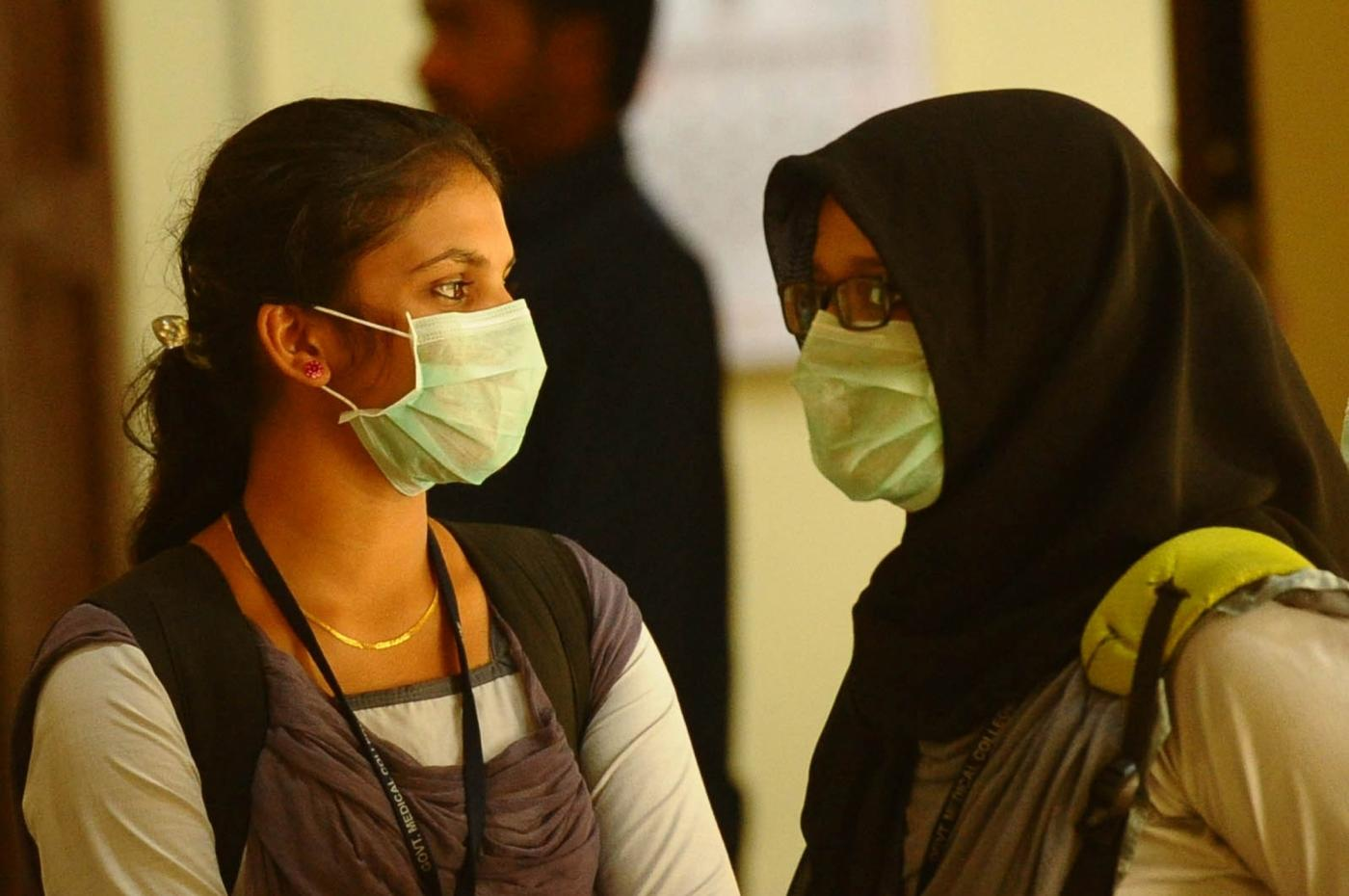 Kozhikode (Kerala): Students wear safety masks as a precautionary measure after the outbreak of 'Nipah' virus in Kozhikode, Kerala on May 22, 2018. (Photo: IANS) by .