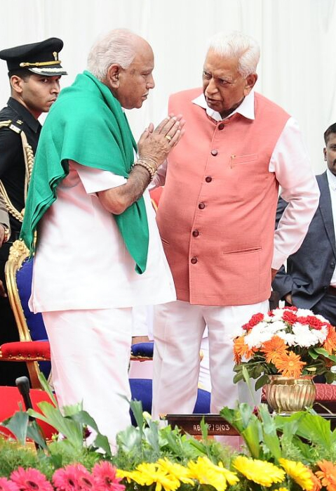 Bengaluru: Karnataka Governor Vajubhai Vala administering oath to BS Yeddyurappa as Chief Minister of Karnataka during his swearing ceremony at Raj Bhavan in Bengaluru on May 17, 2018. (Photo: IANS) by .