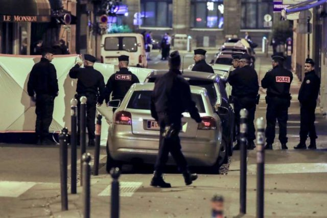 PARIS, May 13, 2018 (Xinhua) -- French police work at the site of a knife attack in the neighborhood of the Opera in Paris May 13, 2018. A man randomly attacked bystanders with a knife on Saturday night in central Paris, Paris prefecture confirmed. (Xinhua/Theo Duval/IANS) by .