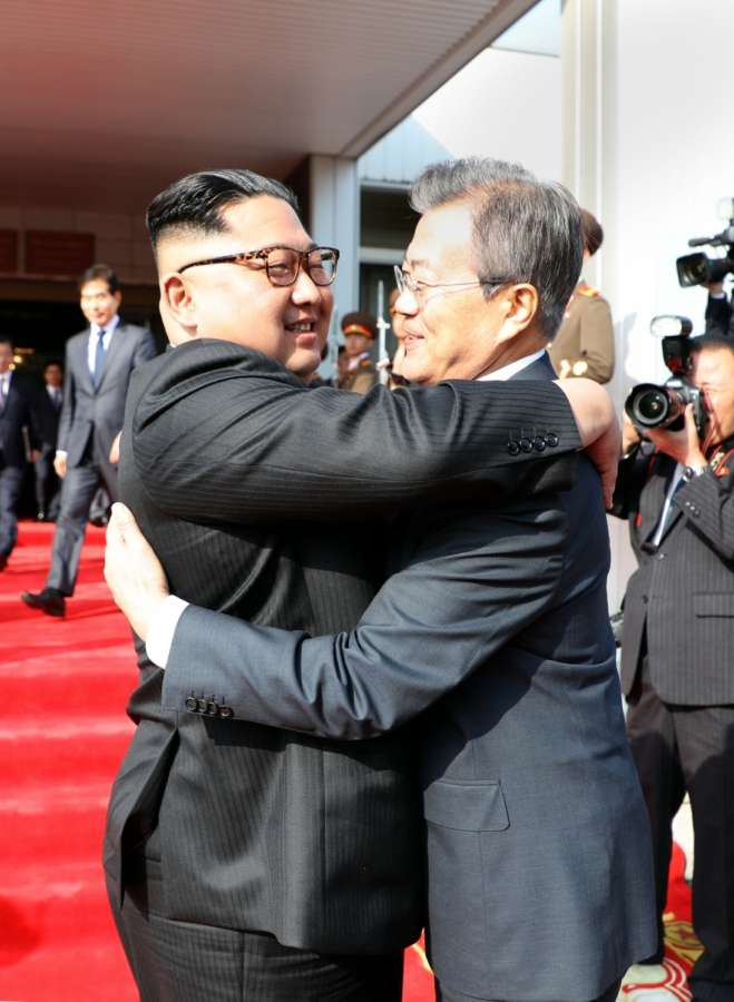 Panmunjom: In this photo provided by Cheong Wa Dae, North Korean leader Kim Jong-un (L) hugs South Korean President Moon Jae-in after their summit at Tongilgak on the northern side of Panmunjom in the Demilitarized Zone on May 26, 2018.(Yonhap/IANS) by .