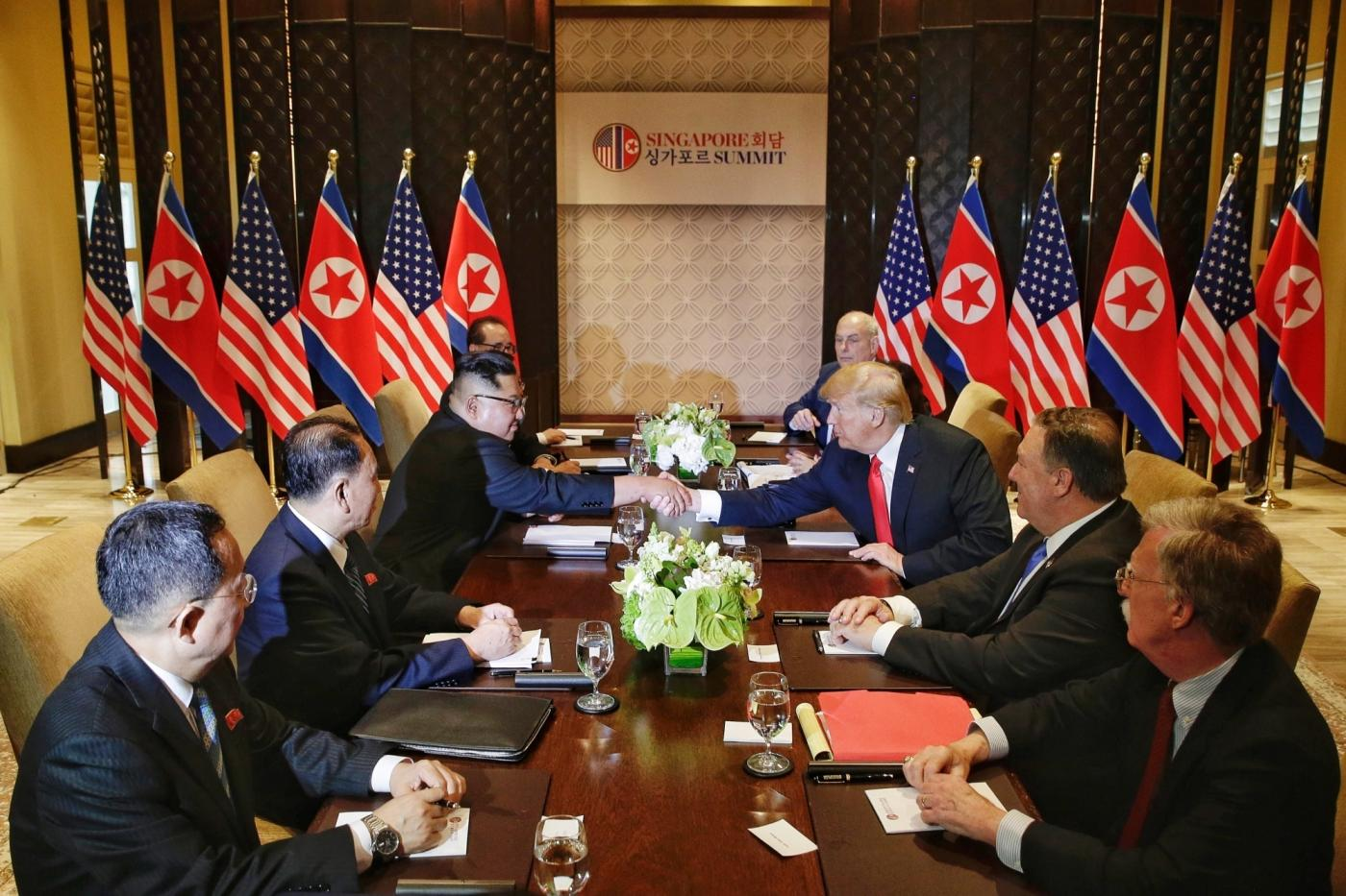SINGAPORE, June 12, 2018 (Xinhua) -- Top leader of the Democratic People's Republic of Korea (DPRK) Kim Jong Un (3rd L) holds talks with U.S. President Donald Trump (3rd R) in Singapore, on June 12, 2018. (Xinhua/Ministry of Communication and Information of Singapore/IANS) by .