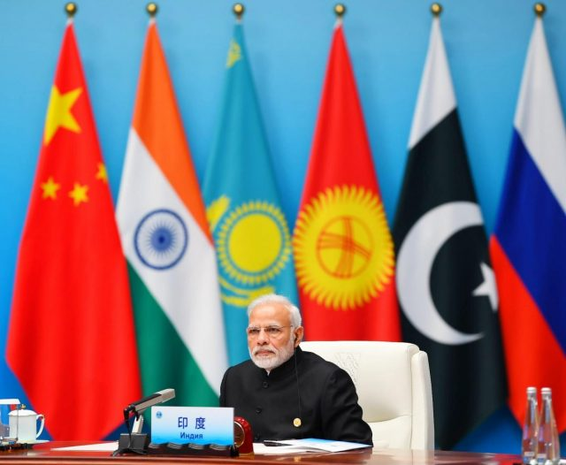 Qingdao: Prime Minister Narendra Modi attends the Restricted Session of the Shanghai Cooperation Organisation (SCO) Summit in Qingdao, China on June 10, 2018. (Photo: IANS/PIB) by .
