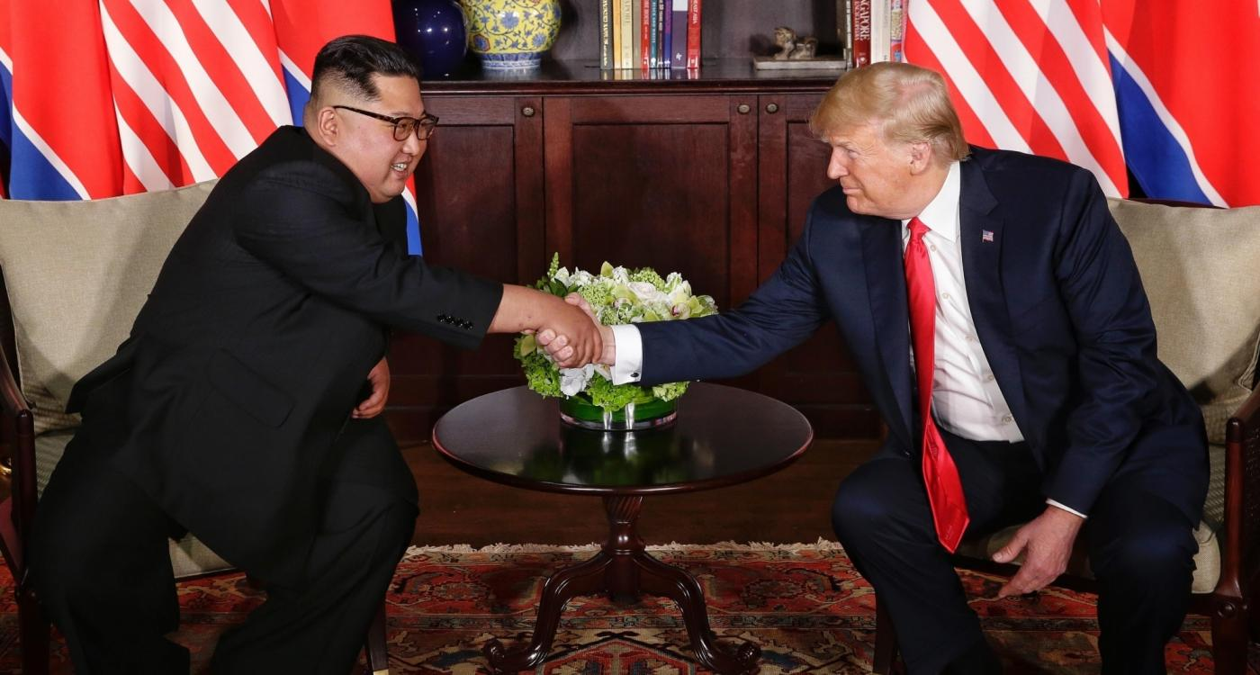 SINGAPORE, June 12, 2018 (Xinhua) -- Top leader of the Democratic People's Republic of Korea (DPRK) Kim Jong Un (L) meets with U.S. President Donald Trump in Singapore, on June 12, 2018. (Xinhua/Ministry of Communication and Information of Singapore/IANS) by .