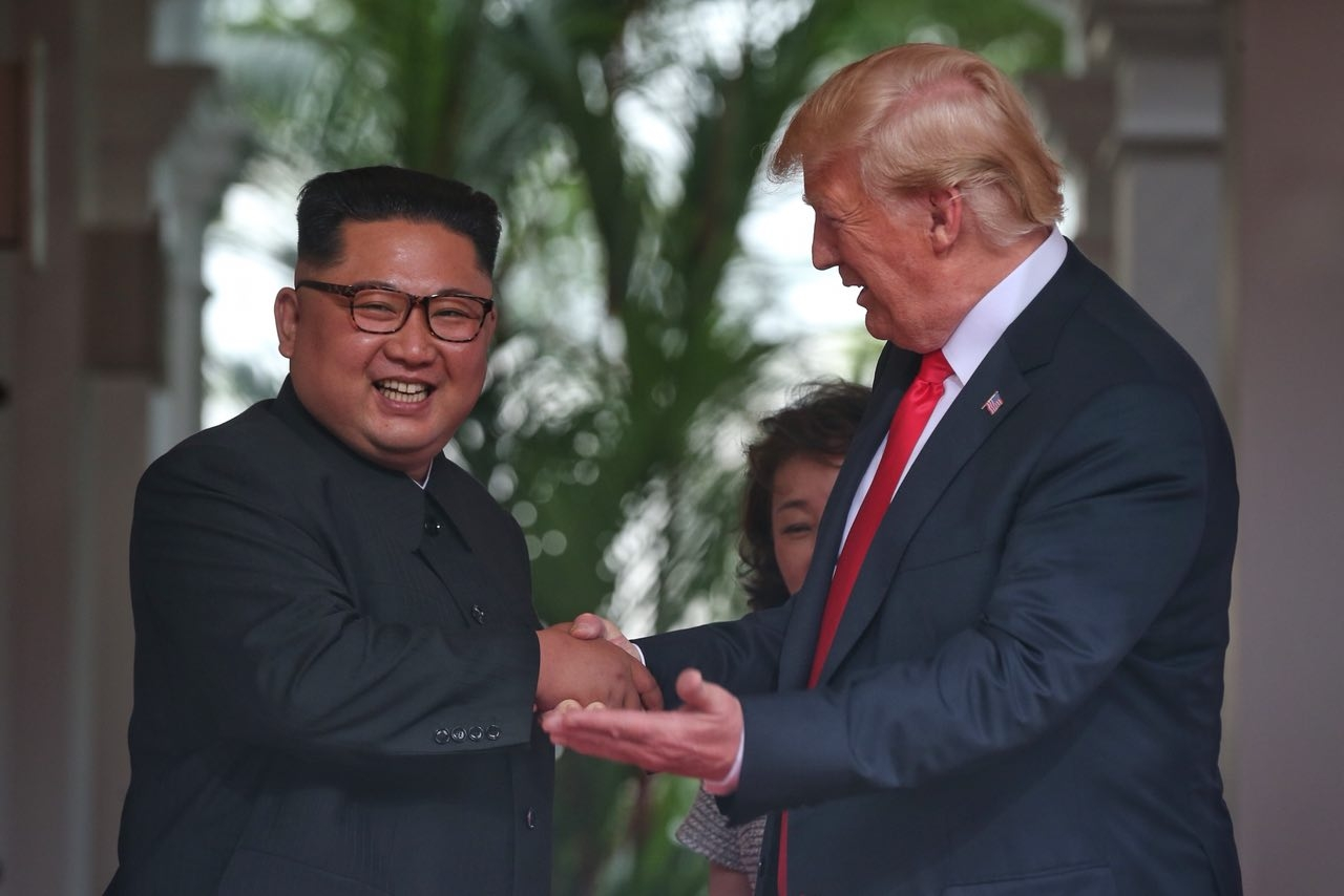 Singapore: U.S. President Donald Trump and North Korean leader Kim Jong-un head for the negotiating table during their historic summit at the Capella Hotel in Singapore on June 12, 2018, in this photo captured from the website of The Strait Times(Yonhap/IANS) by .