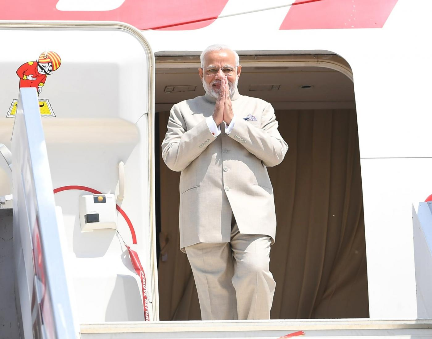 Kampala: Prime Minister Narendra Modi arrives in Kampala, Uganda for second leg of his three-nation state visit to Rwanda, Uganda and South Africa, on July 24, 2018. (Photo: IANS/MEA) by .