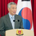 Singapore: Singapore Prime Minister Lee Hsien Loong speaks during a joint press conference with South Korean President Moon Jae-in at the presidential palace in Singapore on July 12, 2018. Moon and Lee agreed to further strengthen the countries' economic and diplomatic cooperation while also working to promote free trade and peace in their region.(Yonhap/IANS) by .