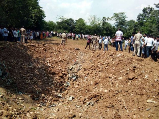 Kangra: People gather at the site where a MiG-21 aircraft crashed in Patta Jattian village of Himachal Pradesh's Kangra district, on July 18, 2018. (Photo: IANS) by .