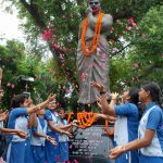 Allahabad:Students pay tributes to freedom fighter Chandra Shekhar Azad on his birth anniversary, in Allahabad on July 23, 2018. (Photo: IANS) by .