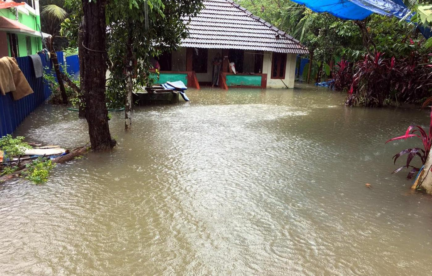 Kottayam : A view of a flooded house at Kottayam of Kerala after heavy rains lashed the city,on July 19, 2018. (Photo: IANS) by .