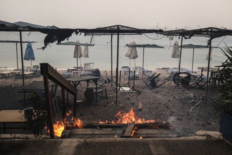 KINETA (GREECE), July 23, 2018 (Xinhua) -- Photo taken on July 23, 2018 shows damaged beach facilities at Kineta near Athens, Greece. Western and Eastern Attica were declared in state of emergency by local authorities on Monday as three major wildfires were raging in suburbs and seaside resorts near the Greek capital, forcing hundreds of residents to abandon their homes and seek refuge by the sea, Greek national news agency AMNA reported. (Xinhua/Lefteris Partsalis/IANS) by .