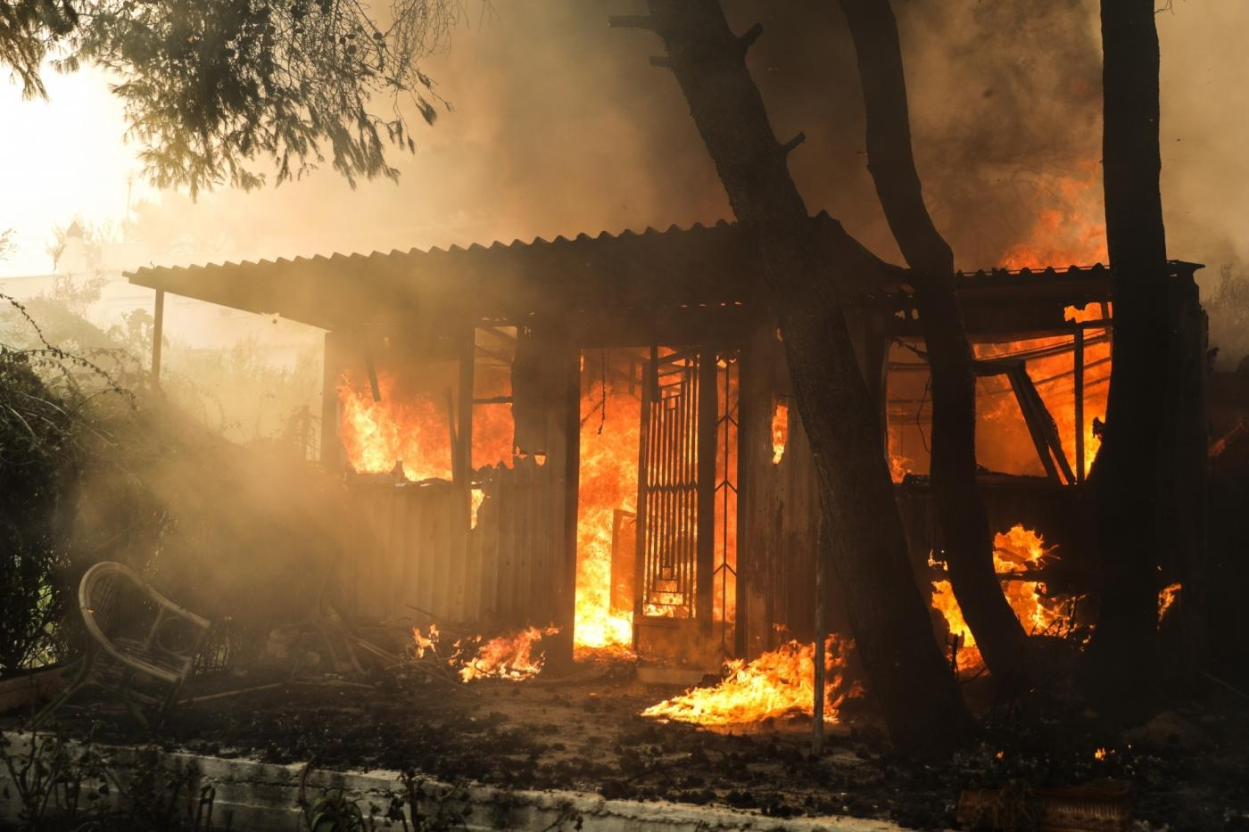 KINETA (GREECE), July 23, 2018 (Xinhua) -- A house is seen burning amid wildfire in the town of Kineta near Athens, Greece, July 23, 2018. Western and Eastern Attica were declared in state of emergency by local authorities on Monday as three major wildfires were raging in suburbs and seaside resorts near the Greek capital, forcing hundreds of residents to abandon their homes and seek refuge by the sea, Greek national news agency AMNA reported. (Xinhua/Lefteris Partsalis/IANS) by .
