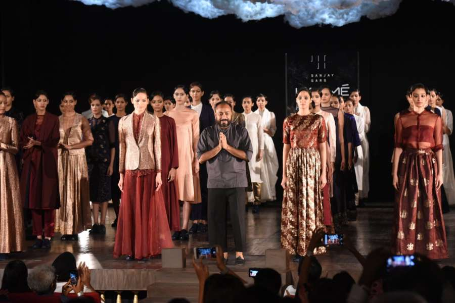 Mumbai: Designer Sanjay Garg unveiled his collection with models during the opening show of Lakme Fashion Week Winter/Festive 2017 on Aug 16, 2017. (Photo: IANS) by .