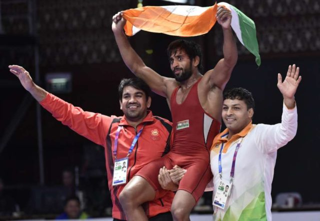 JAKARTA, Aug. 19, 2018 (Xinhua) -- Bajrang Punia (C) of India celebrates after winning gold medal of Men's Wrestling Freestyle 65 kg Final against Takatani Daichi of Japan in the 18th Asian Games at Jakarta, Indonesia, Aug. 19, 2018. (Xinhua/Li He/IANS) by .