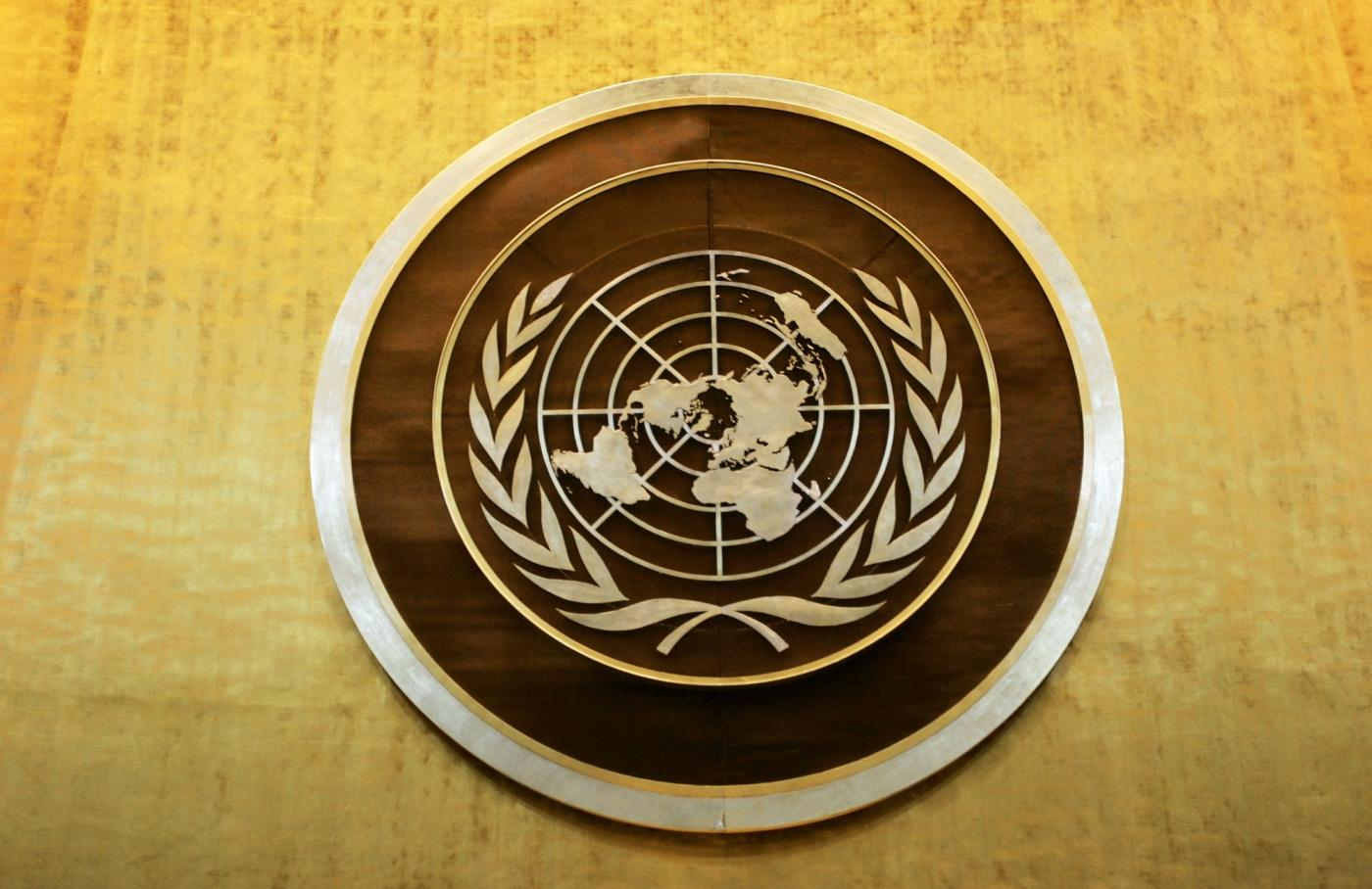 Plaque bearing the United Nations logo above the podium of the General Assembly Hall. (File Photo: Ryan Brown/UN Photo/IANS) by .