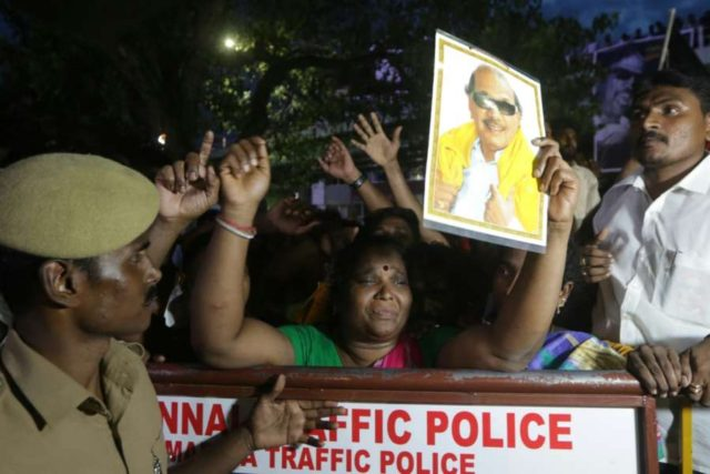 Chennai: Grief struck supporters of Former Tamil Nadu Chief Minister and DMK stalwart M. Karunanidhi outside Kauvery Hospital where he breathed his last in Chennai on Aug 7, 2018. (Photo: IANS) by .