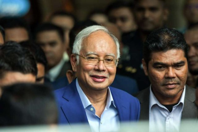 PUTRAJAYA, May 22, 2018 (Xinhua) -- Former Malaysian Prime Minister Najib Razak (L) leaves after being questioned at Malaysian Anti-Corruption Commission (MACC) headquarters in Putrajaya, Malaysia, May 22, 2018. Former Malaysian Prime Minister Najib Razak was questioned by the anti-corruption authority on Tuesday, as investigation related to the state investment company 1MDB gains pace. (Xinhua/Chong Voon Chung/IANS) by .