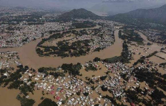 Kerala: An aerial view of the flood-hit Kerala, on Aug 16, 2018. Even as the deadly deluge in Kerala continued to take a toll of life and property across the state -- with the number of deaths rising to 87 on Thursday -- the Centre has deployed all three wings of the armed forces in a massive rescue operation that is currently underway.(Photo: IANS/DPRO) by .