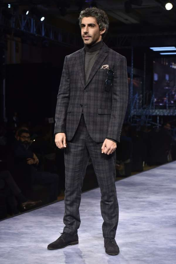 Caption: Showstopper Jim Sarbh looking dapper as he walked the ramp for premium menswear fashion brand SELECTED HOMME for their AW'18 collection by .