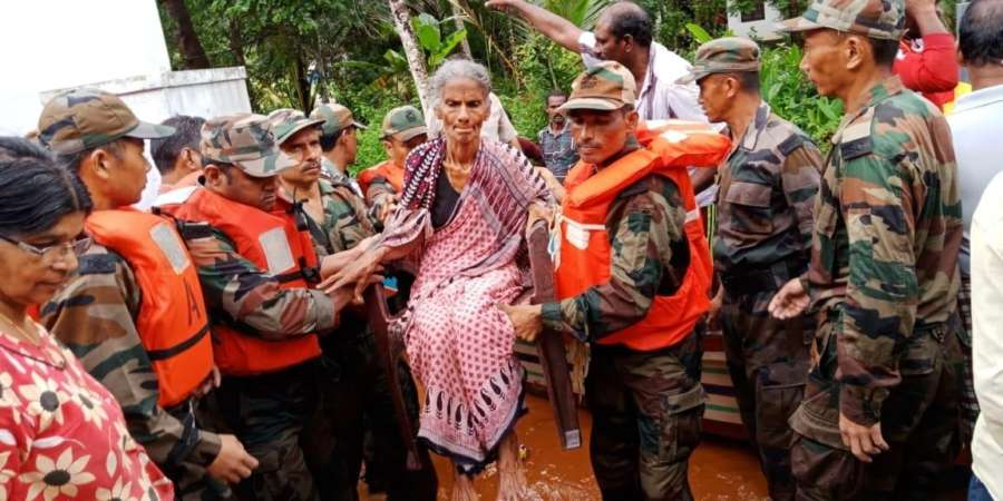 Kerala: Army personnel help an old women at flood affected area, in Kerala, on Aug 17, 2018. (Photo: IANS/PIB) by .