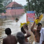 Kochi: Devottees doing Balitharpan at the bank of Periyar near Aluva Mahadeva temple in Kochi on the eve of Karkataka Vavu on Aug 11, 2018. Heavy rain and flood water surrounding the Aluva Siva Temple, dam has been opened with water level continuing to rise in the reservoir in Kerala. (Photo: IANS) by .
