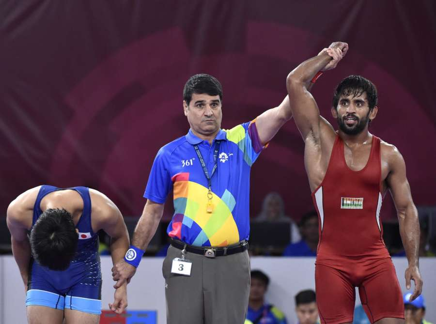 JAKARTA, Aug. 19, 2018 (Xinhua) -- Bajrang Punia (R) of India wins the gold medal of Men's Wrestling Freestyle 65 kg Final against Takatani Daichi of Japan in the 18th Asian Games at Jakarta, Indonesia, Aug. 19, 2018. (Xinhua/Li He/IANS) by .