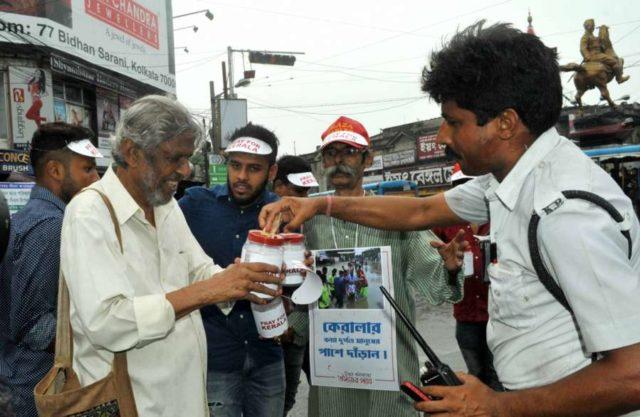 Kolkata: Actor Rudraprasad Sengupta and footballer Debjit Majumder collect donations for the victims of Kerala floods, in Kolkata on Aug 19, 2018. (Photo: IANS) by .