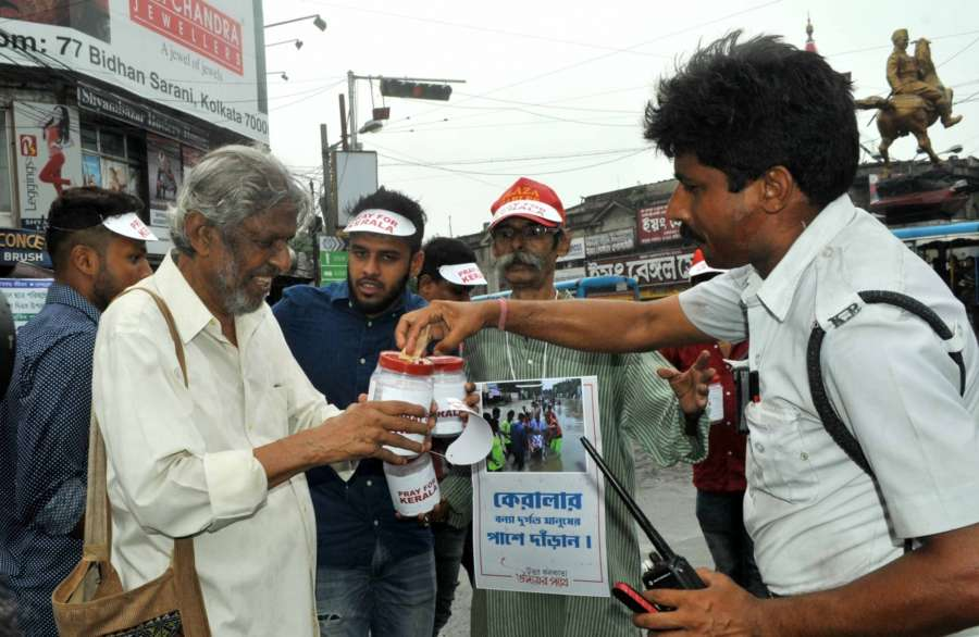Kolkata: Actor Rudraprasad Sengupta and footballer Debjit Majumder collect donations for the victims of Kerala floods, in Kolkata on Aug 19, 2018. (Photo: IANS) by .